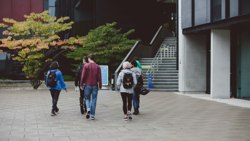 A group of students walk through the Central Courtyard