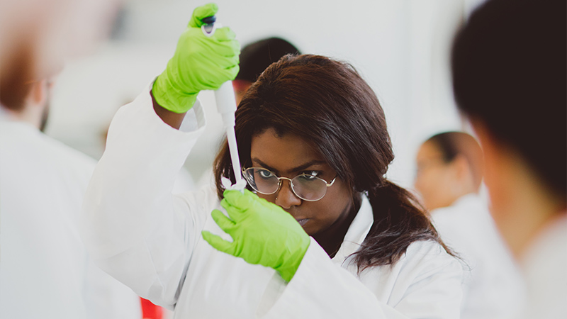 Researcher with pipette