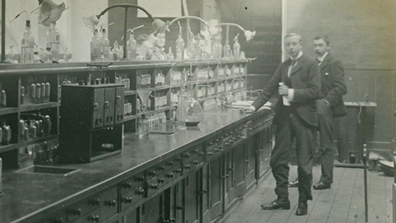 historical science laboratory bench and scientists