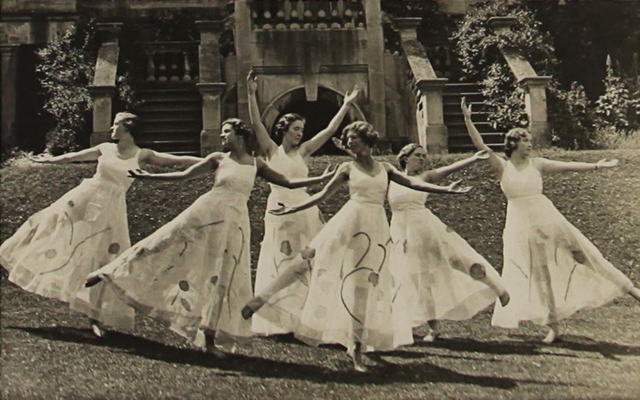 Group of Dorset House students in dance formation in the gardens of the School.