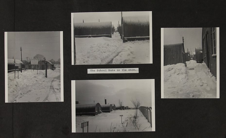 Scrapbook page with four black and white photographs of heavy snow fall around Nissen huts.