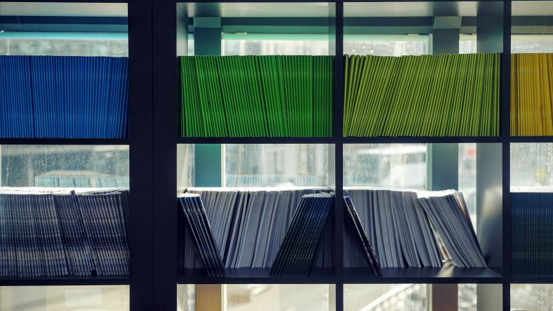 shelves of colourful documents