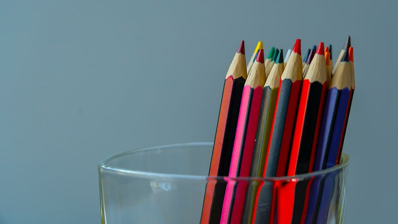 Coloured pencils in a glass