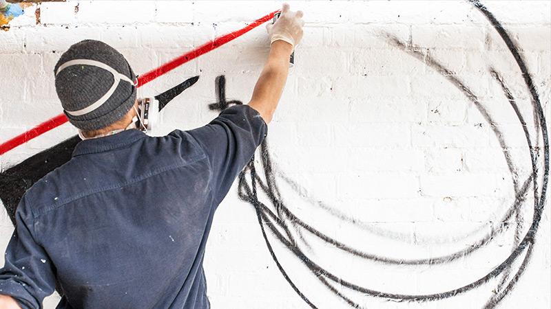 A man spraying paint