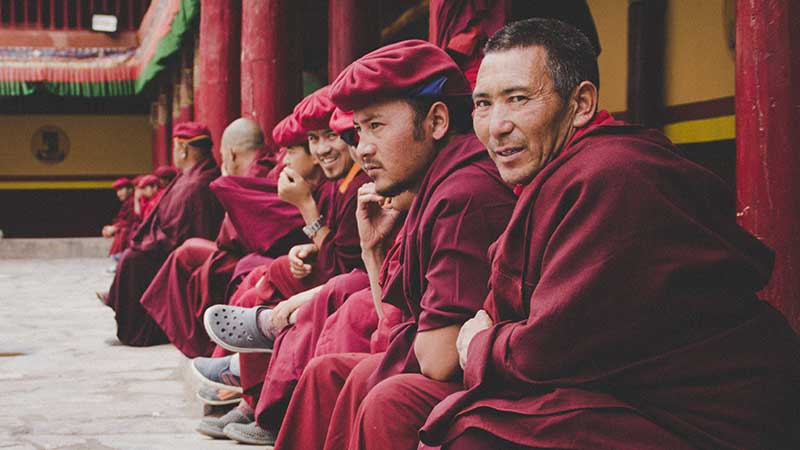 Monks sitting at a temple